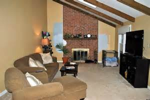 long narrow living room with fireplace in center