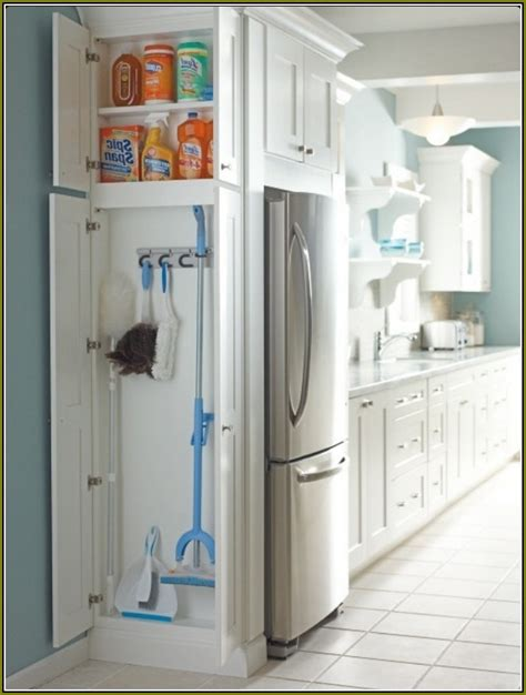 broom storage cabinet wood broom closet cabinet lowes home design ideas