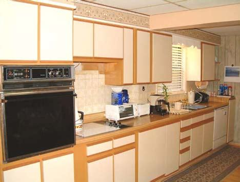 painting melamine kitchen cabinet doors painting white melamine cabinets with oak trim cabinets