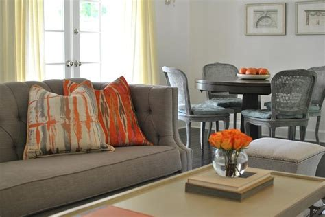 Orange And Gray Living Room by Gray And Orange Living Room Features A Gray Tufted High