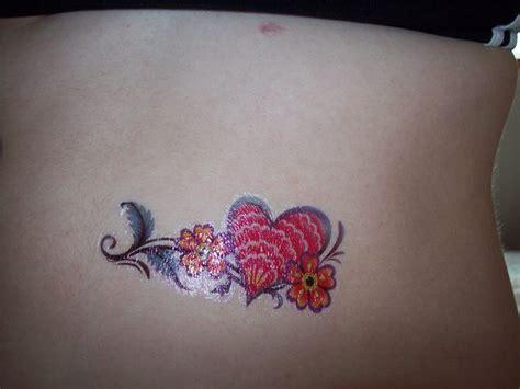 tattoo flower heart heart flower female tattoo ideas