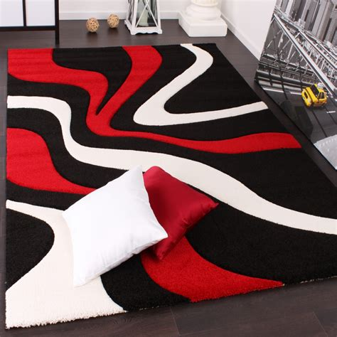 teppich rot schwarz designer teppich mit konturenschnitt wellen muster rot
