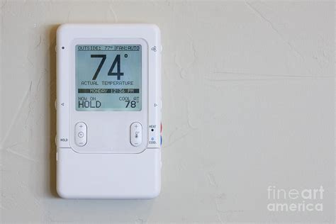 home thermostat and climate controller photograph by