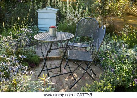 Cottage Garden Patio With Metal Table Furniture And Cottage Patio Furniture