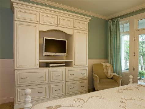 Bedroom Entertainment Center Ideas by The White Armoire Provides Functional Storage And