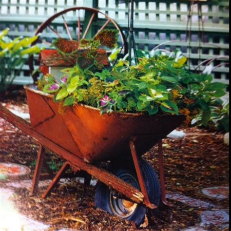 Wheelbarrow Planter by Wheelbarrow Planter Home
