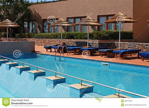 Pool Beds by Poolside With Pool Bed And Umbrella Stock Photo Image