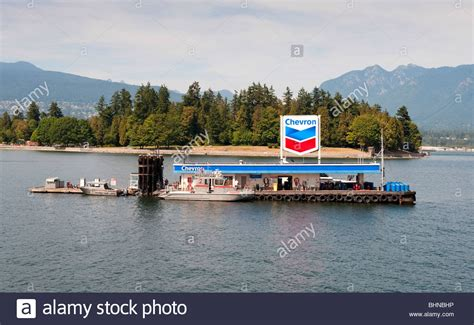 floating boat photo floating chevron fuel station for boats in coal harbour