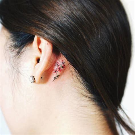 flower tattoo behind ear meaning beautiful floral tattoos behind the ear