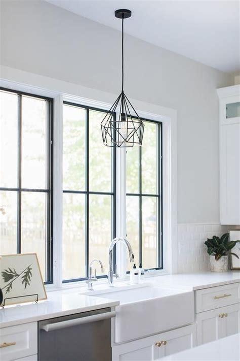 black geometric pendant light hangs  front   row