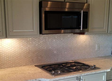 white hexagon of pearl shell tile kitchen