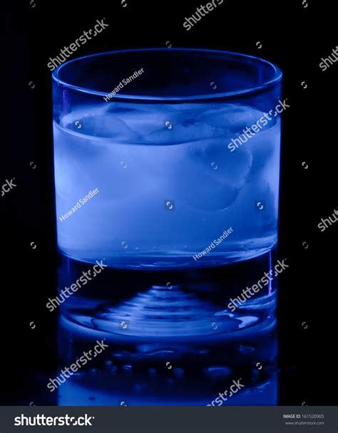 glass that glows black light glass iced tonic water glows blue stock photo 161520905