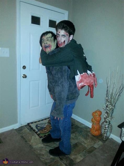 zombie carrying split   zombie illusion halloween