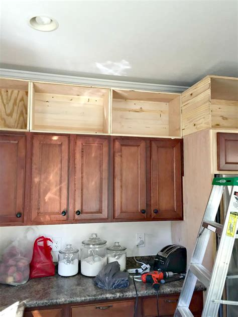 Add Drawers To Kitchen Cabinets by Building Cabinets Up To The Ceiling From Thrifty Decor