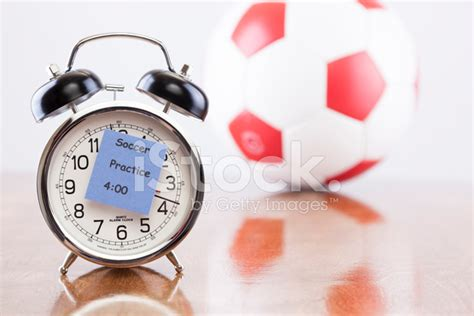 sports time alarm clock with soccer practice ba stock photos freeimages