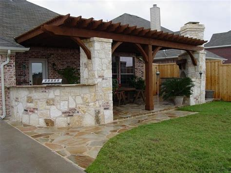 outdoor kitchen flagstone patio fireplace patio cover
