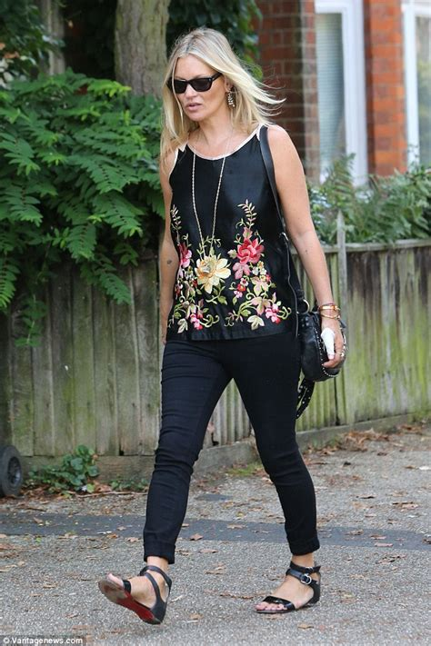 Unlike Kate Moss Is A Real Stylist by Kate Moss Cuts A Typically Chic Figure In A Satin Floral