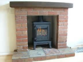 gas stove and brick built fireplace