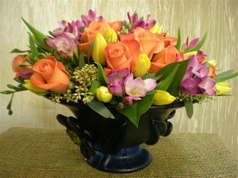 Bunga Dinding Tulip Spray low lush for springtime orange roses yellow tulips purple freesia and seeded eucalyptus