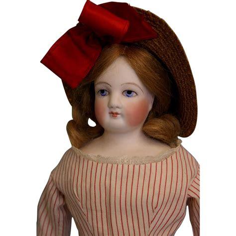 clean bisque doll antique 14 inch blue eyed bisque fashion doll