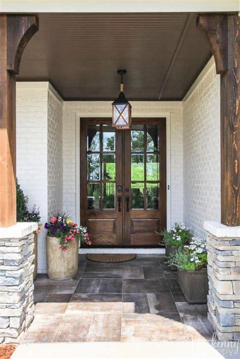 double glass front doors  rock  rustic front porch