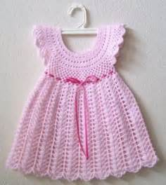 Touch of baby pink colored silken ribbon on a light pink crochet baby