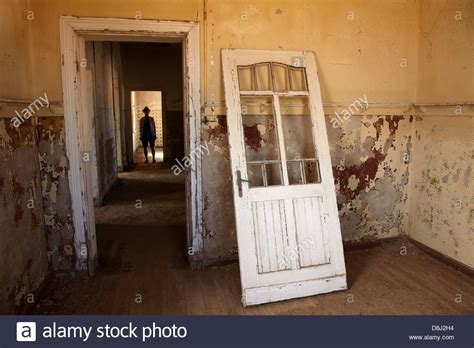 buying a house with another person person in corridor in abandoned house kolmanskop ghost town near stock photo