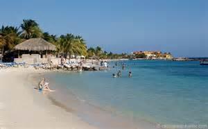 curacao beaches the sun the sand the surf the palm trees