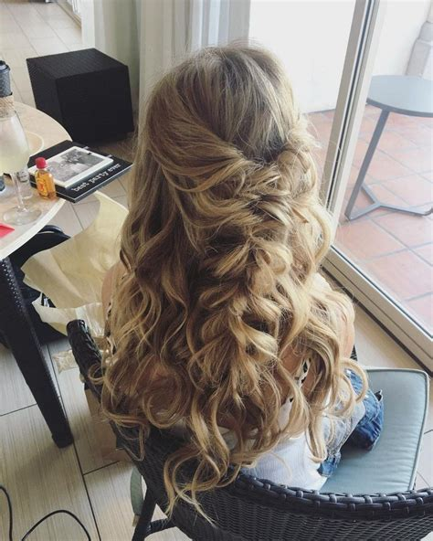 beautiful half half up braided hairstyle with curls