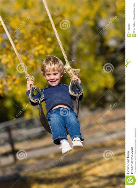 kid on swing kid on swing royalty free stock photo image 11963665