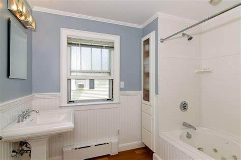 how high should wainscoting be in a bathroom cottage full bathroom with wainscoting drop in bathtub