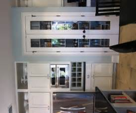 kitchen doors double door: accessible through glass fronted double doors beside the microwave and