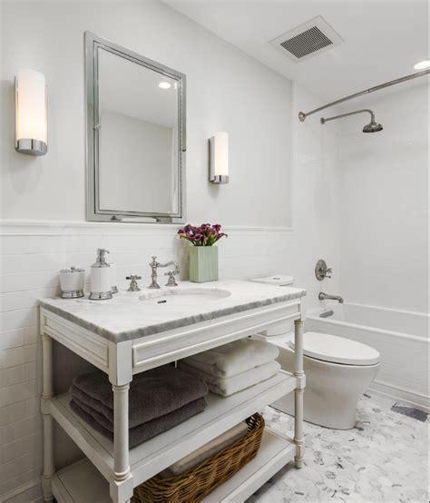white marble tile floor white subway tile  wall  chair rail sconces chrome condo