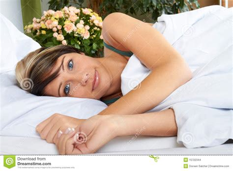 girl lying bed with flowers attractive woman in bed stock images image 15722344