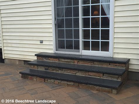 retaining wall bench retaining wall sitting bench walls patio custom bluestone steps plantings in bel