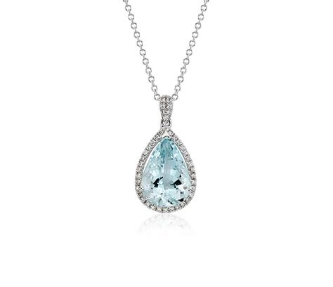aquamarine and halo pendant in 14k white gold