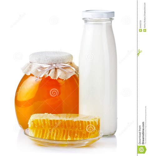 And Milkhoney sweet honey in glass jars with honeycombs and bottle of