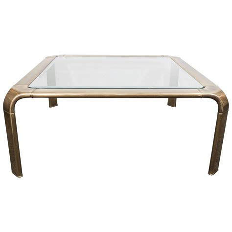 1970s brass and glass waterfall coffee table by