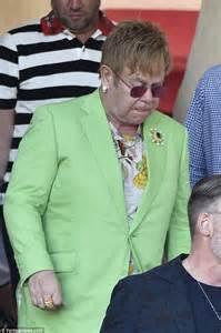 elton john zara t shirt elton john makes in garish green suit with husband david