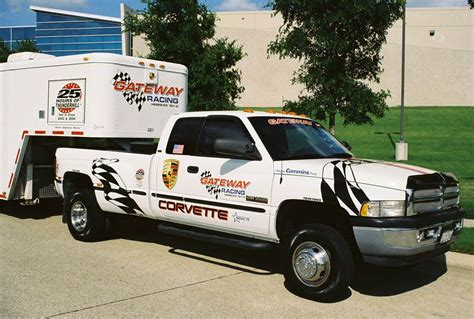 highly modified dually race team pull truck dodge