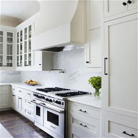 white kitchen bronze hardware white shaker cabinets with orb knobs design ideas