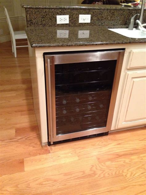 kitchen island with refrigerator wine fridge in kitchen house