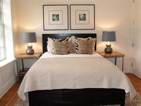 over bed art how to design a room around a black bed