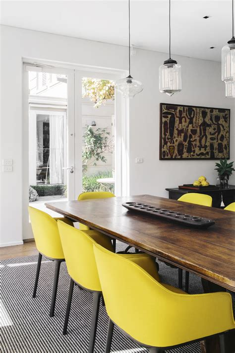 yellow dining room table dining room white wood fresh crisp and clean vibe yellow chairs yellow as a pop