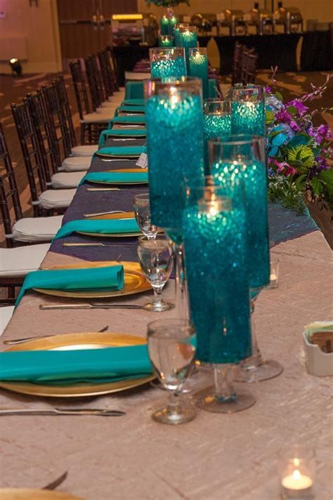 Teal and purple wedding reception decor; candle design