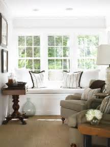 living room window built in window seat cottage living room courtney giles interiors