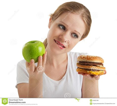 woman makes choice healthy and unhealthy foods royalty