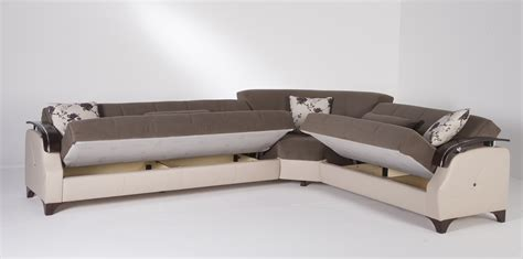 Black leather sleeper sectional sofa with cushions combined rectangle gray fur rug placed on