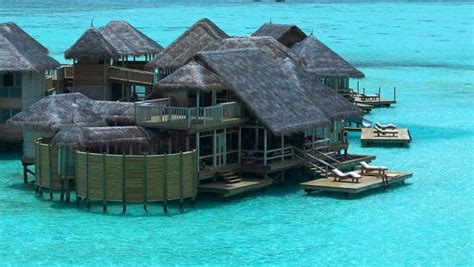 overwater bungalows bali indonesia stunning overwater bungalows around the world for a