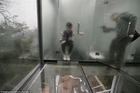 see through public bathroom world s first glass toilet unveiled in china s nature park